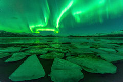 Northern lights (Aurora borealis) reflection across a lake in Iceland. Royalty Free Stock Images