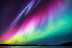 Northern lights (Aurora borealis) in the sky. Colorful Northern lights (Aurora borealis) in the sky Stock Images