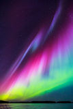 Northern lights (Aurora borealis) in the sky Stock Photos