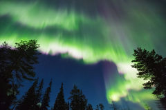 Northern lights (Aurora borealis) in the sky. Colorful Northern lights (Aurora borealis) in the sky stock photo