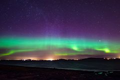 Northern lights aurora at seaside color in Norway stock photos