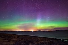Northern lights aurora at seaside color Norway stock photos
