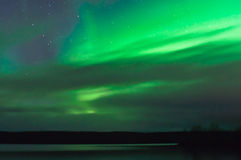 Northern lights behind clouds Royalty Free Stock Photos