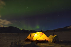 Northern lights at campsite royalty free stock photo