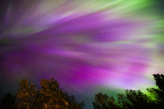 Northern lights Crown (Aurora borealis) in the sky. Colorful Northern lights Crown (Aurora borealis) in the sky royalty free stock photo