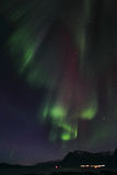 Northern Lights curtains over Brenna Royalty Free Stock Images