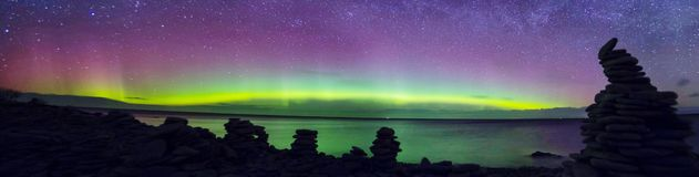 Northern lights in Estonia. Northern lights panorama photographed in Saaremaa Estonia Royalty Free Stock Photography