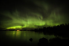 Northern lights in Finland. Northern lights (Aurora Borealis) shining bright on a night sky Royalty Free Stock Image