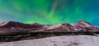 Northern Lights. The Northern green lights over mountains in Alaska Stock Image