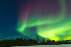 Northern Lights. Greenish And Maroon Dancing Swirls Of The Aurora Borealis Against A Starry Sky Royalty Free Stock Photo