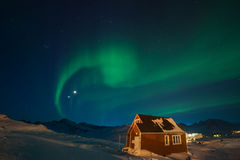 Northern lights in Greenland. Winter night and northern lights in Tasiilaq, East Greenland Royalty Free Stock Photo