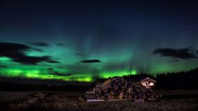 Northern Lights with a isolated house in the foreground stock images