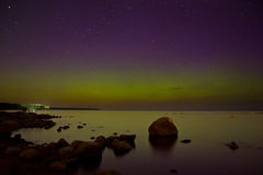 Northern lights on lake Ladoga in April 2016 Stock Photography