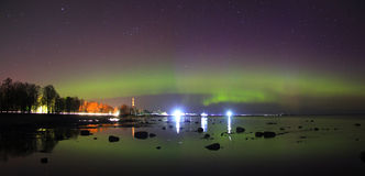 Northern lights on lake Ladoga in April 2016 Stock Images