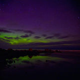 Northern lights on lake Ladoga in April 2016 Stock Photos