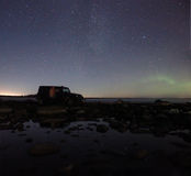 Northern lights on lake Ladoga, Russia, November 03, 2015 , travel by Jeep Wrangler Stock Photos