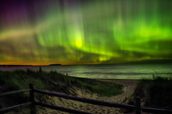 Northern lights on lake superior over autrain beach in northern Royalty Free Stock Images