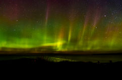 Northern lights on lake superior over autrain beach in northern Stock Photography