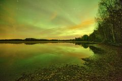 Northern lights lakescape at night Stock Image