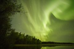 Northern lights lakescape at night Stock Photo