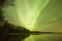Northern lights lakescape at night Royalty Free Stock Image