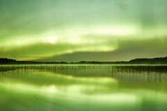 Northern lights lakescape at night Royalty Free Stock Photography