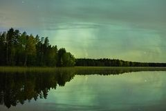 Northern lights lakescape at night Stock Images