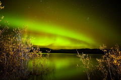 Northern lights mirrored on lake Stock Images