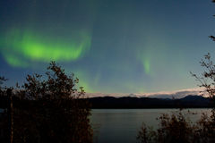 Northern Lights moon-lit clouds over Lake Laberge Stock Photography