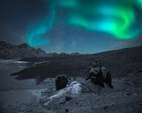 Northern lights in the mountains and plains stock photography