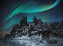 Northern lights in the mountains and plains royalty free stock photo