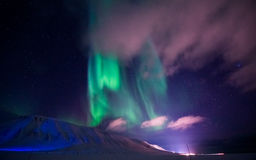 The Northern lights in the mountains of Svalbard, Longyearbyen, Spitsbergen, Norway wallpaper. The polar Northern lights in the mountains of Svalbard stock image