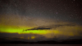 Northern lights and myriad of stars Royalty Free Stock Photos