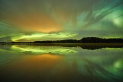 Northern lights and night clouds Royalty Free Stock Photography