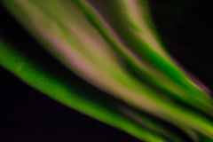 Northern lights in the night sky. Stock Image