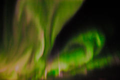 Northern lights in the night sky. Royalty Free Stock Image