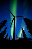 Northern Lights night sky wind turbine silhouette Stock Photos