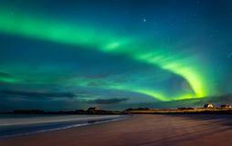 Northern lights, Norway. Northern lights, beautiful landscape of a green light in the night starry sky, amazing natural beauty of Lofoten archipelago, Gimsoya stock images