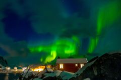 Northern Lights on the Norwegian Village stock photography