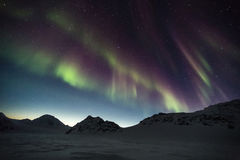Northern Lights over the Arctic mountains - Spitsbergen, Svalbard Royalty Free Stock Photography