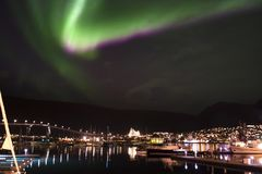 NORTHERN LIGHTS OVER THE CITY LIGHTS stock image