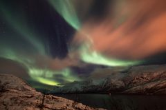 Northern lights over Ersfjord, Norway stock photo