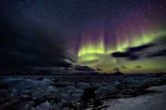 Northern Lights over the frozen Arctic fjord Royalty Free Stock Photos