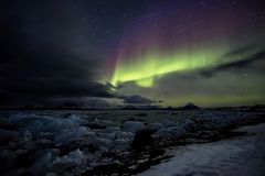 Northern Lights over the frozen Arctic fjord Stock Image