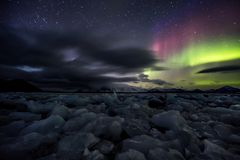 Northern Lights over the frozen Arctic fjord Stock Images