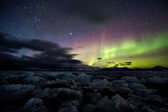 Northern Lights over the frozen Arctic fjord Royalty Free Stock Photo