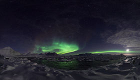 Northern lights over the frozen fjord - PANORAMA Royalty Free Stock Photo