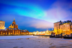 Northern lights over the frozen Old Port in Katajanokka district with Uspenski Orthodox Cathedral in Helsinki Finland Stock Photo