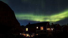 Northern lights over huts in Hamnoy Stock Photography