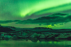 Northern lights over the ice lagoon, Iceland Royalty Free Stock Images